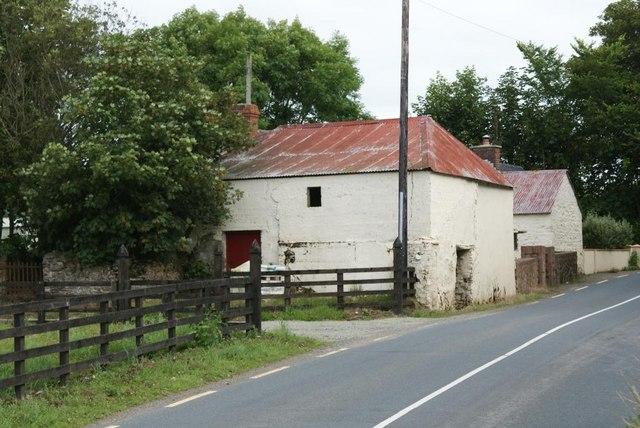 Barns beside the R742 at Ballynamona
