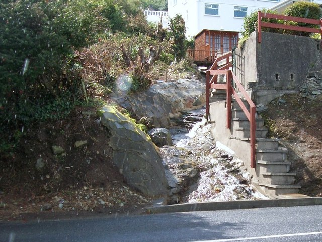 A hill-side rill disappearing beneath the A2 Kilkeel Road