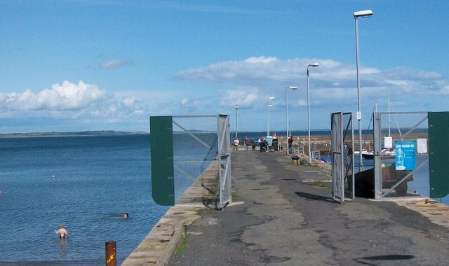 The north wall of Newcastle's Harbour, together with two intrepid lady swimmers