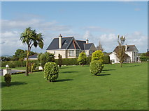 S5509 : Garden and houses, Butlerstown by David Hawgood