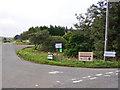 NG3534 : Signs at the junction by Richard Dorrell