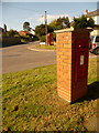 SY4794 : Bradpole: postbox № DT6 91 and phone, Court Close by Chris Downer