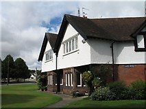 SJ3384 : Houses at Port Sunlight  (Roughcast, Red Sandstone Bay Windows) by Gerald Massey