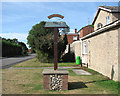 TG3608 : Lingwood village sign in Post Office Road by Evelyn Simak