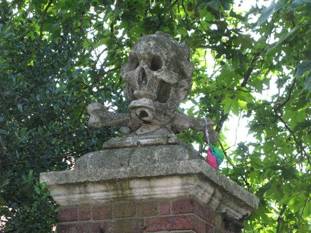 Skull & crossbones on the gatepost at the entrance to St. Nicholas' Church, Deptford Green, SE8