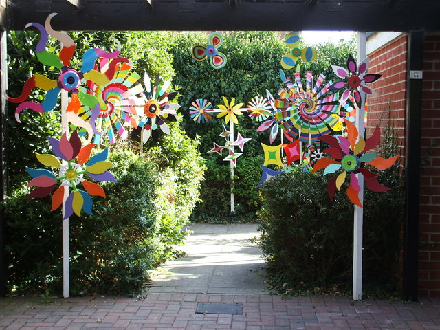 Colourful windmills decorate a garden near to Abingdon town centre