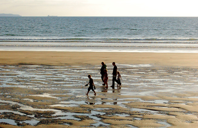 Family footsteps in the evening on Newgale beach