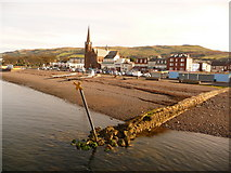 NS2059 : Largs: yellow cross by the harbour by Chris Downer