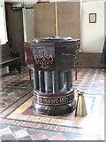 TM0099 : St Peter's church - C19 baptismal font by Evelyn Simak