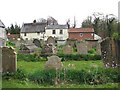 TG3818 : St Catherine's church - view across the churchyard by Evelyn Simak