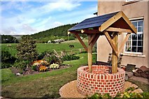 NZ5906 : New Well Head, Bank Foot Farm Cottage by Paul Buckingham