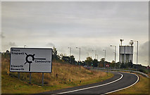 TL3160 : Slip road and water tower on the A428 - Cambourne by Mick Lobb