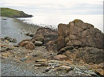 NX4235 : Rocky shoreline at low tide by Ann Cook