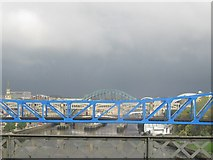 NZ2463 : Tyne bridges on a stormy day by don cload