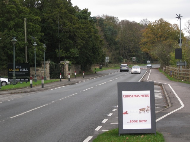 A-board and passing bay at the turn in to the Saxon Mill
