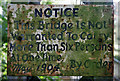 NY3971 : A notice on Netherby Bridge at the River Esk by Walter Baxter