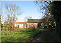 TG2002 : Barns at Gowthorpe Manor by Evelyn Simak