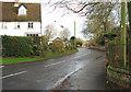 TM1986 : Harleston Road past Drayton House by Evelyn Simak