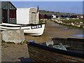 SY6768 : Beach Huts and Fishing Boats near Portland Bill by Gillian Thomas