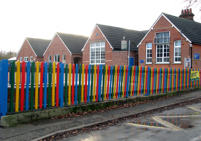 Colourful fence surrounding Tivetshall Primary School