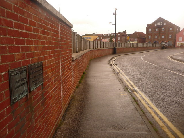 Wells-next-the-Sea: flood defences and water-level plaque
