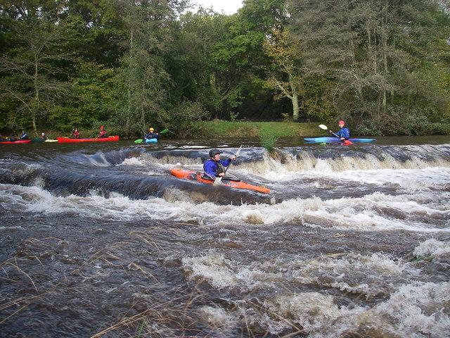 Kayaking Staverton weir in high water
