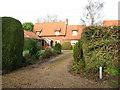 TM1598 : Cottage in Wymondham Road by Evelyn Simak
