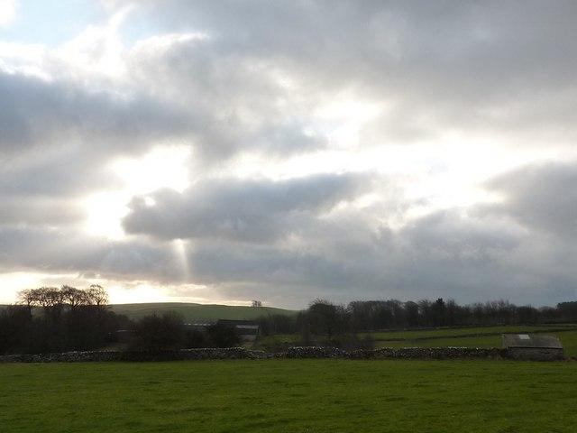 Woodside Farm under a ray of sunlight