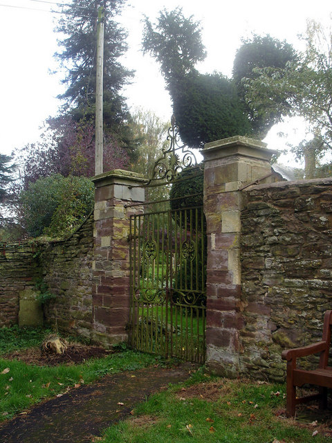 Giant topiary fowl watches Dore Abbey gate