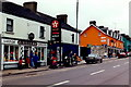 M9380 : Strokestown - Grocery, Petrol Station, Percy French by Joseph Mischyshyn