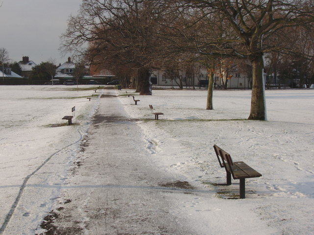 Empty benches in the snow