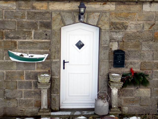 Doorway with coble fishing boat planter, Boulby