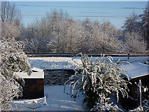 TM0855 : Snow scene - back room view by Andrew Hill