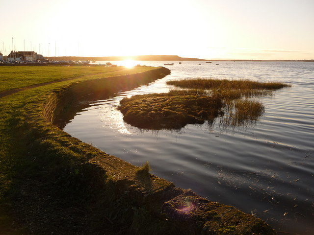 Mudeford: view along harbour's edge into the sun