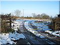 SP8520 : Field entrance at sharp bend on Wingrave road by John Firth