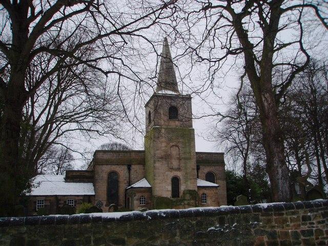 Gosforth Parish Church through the trees