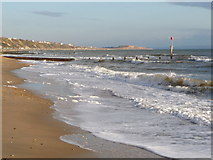 SZ1191 : Boscombe: rough seas and view along beach by Chris Downer