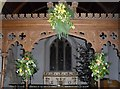 SU8518 : Seasonal flowers within St Mary, Bepton by Basher Eyre