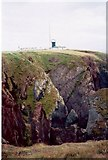 SM8003 : Cliffs and the lighthouse on St Ann's Head by Richard Law