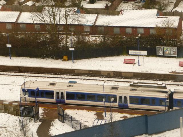 Wembley: eastbound train at Wembley Stadium Station