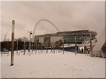 TQ1985 : Wembley: the stadium from snow-covered footbridge by Chris Downer