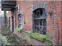 TG2407 : Trowse pumping station - broken windows by Evelyn Simak