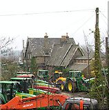 TG2407 : Tractors parked by Trowse railway station by Evelyn Simak