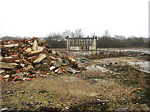 TG2407 : The Deal Ground - rubble beside the only remaining building by Evelyn Simak