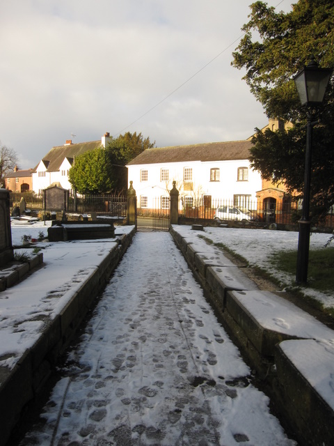 The north path and gates at All Saints, Gresford