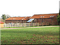TG1607 : Barn conversions at Manor Farm by Evelyn Simak