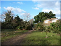 SZ0995 : Bournemouth : Muscliff - Footpath & House by Lewis Clarke