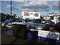 SZ0995 : Bournemouth : Moordown - Cars-4-Less & Mike Stokes by Lewis Clarke