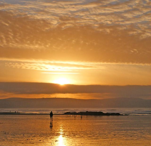 A sunset sky over Gwithian beach