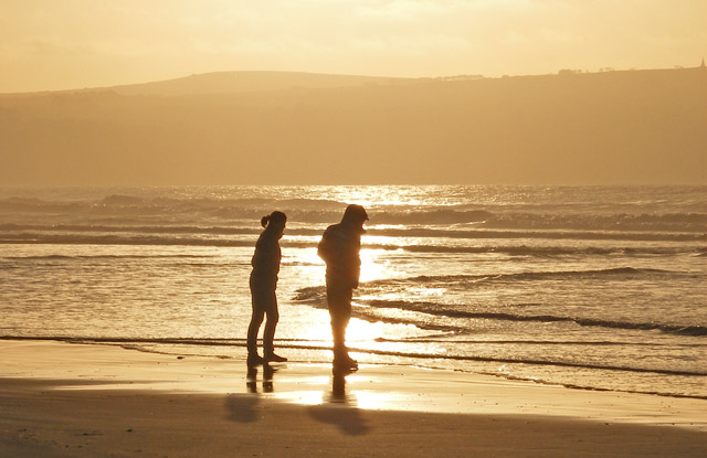 Silhouettes at sunset on Gwithian beach